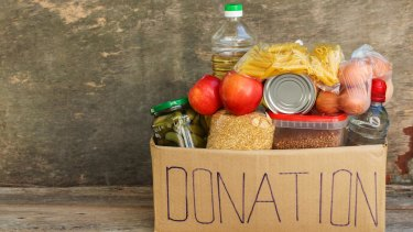 Shopping for a food drive will help the needy, but donating cash to the food bank will probably be more effective.