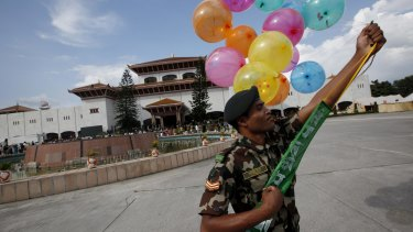 A Nepalese Army soldier holds balloons to decorate the constituent assembly on Sunday, in celebration of the nation's new constitution.