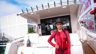 Model Shanina Shaik welcomes guests to the Mumm yacht.