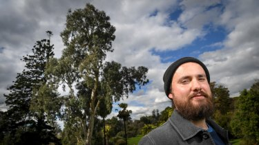 Ryan Prehn and the remnant river red gum, which could be up to 300 years old, according to the Royal Botanic Gardens.
