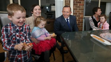 Prime Minister Tony Abbott meets with Skye Mendl (left) and her children Austin and Evelyn, and Vanessa Burdett (right) and her daughter Stella on Monday.