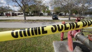 Crime scene tape runs outside Marjory Stoneman Douglas High School on Sunday.