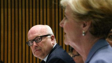 Attorney-General George Brandis and Australian Human Rights Commission president Professor Gillian Triggs during a Senate hearing at Parliament House in Canberr.