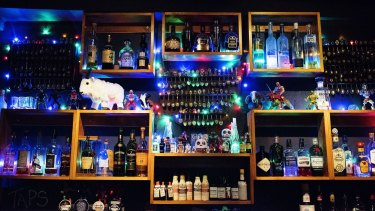 Display cases add to the bar's eclectic and friendly vibe.