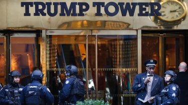 Members of the New York Police Department guard Trump Tower.