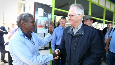 Prime Minister Malcolm Turnbull is greeted during a supermarket in Ceduna in South Australia.