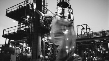 A fashion illustration for Fibremakers shows  Maggie Eckhardt gyrating at the Altona Petrochemical plant. From 1966. Henry Talbot Fashion Photography Archive.
