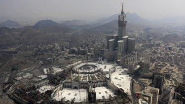 Abraj Al-Bait Towers with the four-faced clocks stands over the Grand Mosque, where a crane collapsed earlier in September killing dozens. File photo.