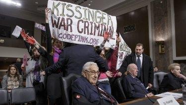 Protesters interrupt former US secretary of state Henry Kissinger.