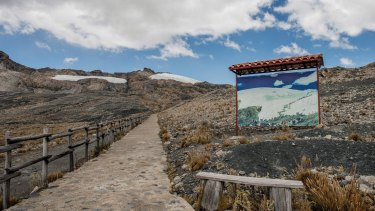 A 30-year-old photograph taken from a nearby location is placed on the path to the Pastoruri glacier in Ancash, Peru, showing how far the ice has retreated.