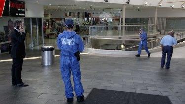 Police investigate a shopping centre in Auburn.