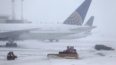 Snowplows work to keep the grounds clear at Newark Liberty International Airport in Newark, New Jersey.
