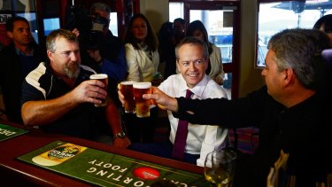 Bill Shorten has a beer with Beaconfield Mine survivors Todd Russell and Brant Webb shortly after launching his election campaign in Tasmania.