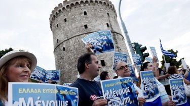 Pro-Euro demonstrators gather during a rally in the northern Greek city of Thessaloniki's landmark White Tower.