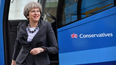 Theresa May steps off the bus to visit the Cheltenham Science Festival on June 6.