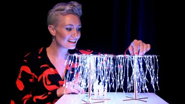 Lucy Keeler with a scale model of the light installation titled Let it Snow.