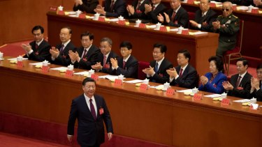 Chinese President Xi Jinping walks to the podium to open the 19th Party Congress at the Great Hall of the People in Beijing, on Wednesday.