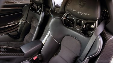 Tightly bolstered carbon bucket seats set the scene.