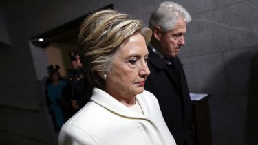 Former Presidential Bill Clinton and wife Hillary Clinton arrive on the West Front of the Capitol in Washington, Friday, January 20, 2017, for the presidential inauguration of Donald Trump.