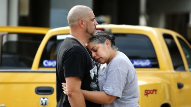 Ray Rivera, a DJ at Pulse nightclub, is consoled by a friend after the shooting.