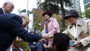 Japanese pastors greet Kim Bok-dong in an act of repentance and reconciliation.