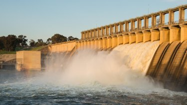 The Hume Dam spillway spectacle has attracted hundreds of people.