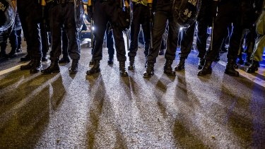Police officers stand guard during clashes with pro-democracy protesters in Hong Kong.