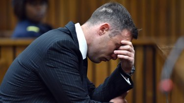 Oscar Pistorius with his head in his hands as he faces the High Court in South Africa.