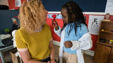 "Carlton Primary School has used donations to create a new preschool program. ""Doctor"" Aisha looks at teacher Sarah Watson's sore throat."