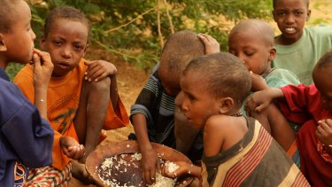 New child asylum seekers into Kenya Dadaab refugee camp from Somalia eat their first meal in days.
