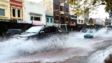 Epic journey: Drivers negotiate Oxford Street, Paddington during the Sydney storms.