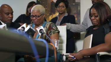 Sandra Bland's oldest sister Shante Needham, centre, becomes emotional as she tries to answer a question from a reporter at a news conference about her sister's death.