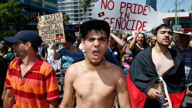 A man shouts slogans about Aboriginal rights in Australia during a protest against G20 leaders in Brisbane in 2014.