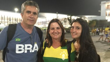 Father Joao, mother Arlene and daughter Paula, at Olympic Park, have different views on booing.