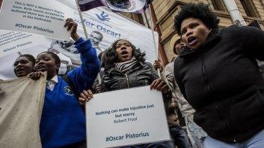 Oscar Pistorius supporters gather opposite North Gauteng High Court.
