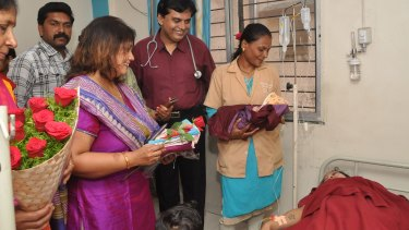 A new mother receives Dr Ganesh Rakh, staff and visitors bearing gifts after she delivered a baby girl.