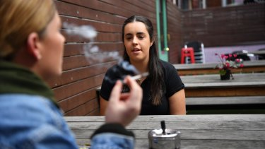 Bryony Fitzgerald, manager of the Last Jar, with a smoker in the beer garden.