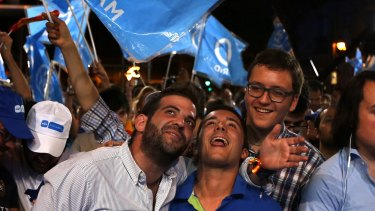 Followers of Spain's acting Prime Minister  Mariano Rajoy celebrate the election results in Madrid.