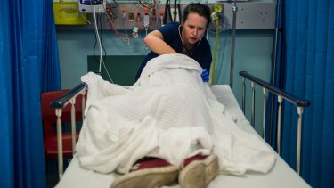 Dr Clare Foss treats an intoxicated male in the emergency department at Calvary Hospital.