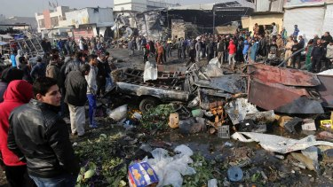 The scene after a car bomb explosion at a crowded outdoor market in eastern Baghdad.