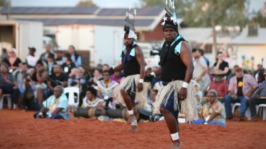 Performers from Muakgau Lak Gubau Gizu (Thursday Island) at Mutitjulu on Tuesday.