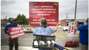 Protesters against child abuse within the Catholic Church stand  the front of the Ballarat Magistrate's Court before the Royal Commission into Institutional Responses to Child Sexual Abuse begins.