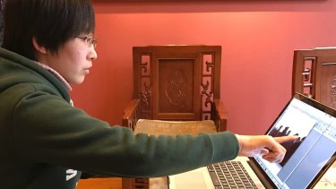 Jia Jingyuan, sister of Jia Jinglong, shows the video footage she took showing her house being demolished.