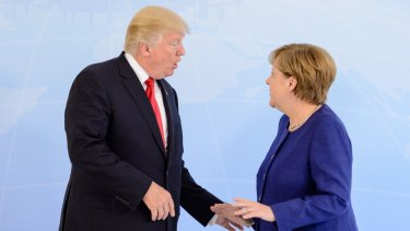 German Chancellor Angela Merkel receives US President Donald Trump in the Hotel Atlantic, on the eve of the G20 summit, for bilateral talks.