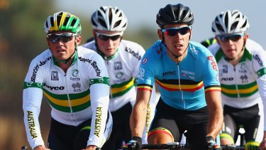 Having his say: Simon Gerrans (left) rides during training for the UCI World Road Race Championships.