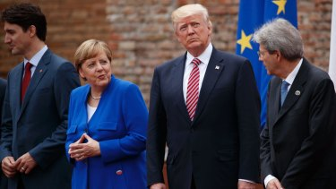 G7 leaders at Friday's meeting: Canadian Prime Minister Justin Trudeau, German Chancellor Angela Merkel, President Donald Trump, and Italian Prime Minister Paolo Gentiloni.