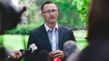Senator Di Natale announcing an initiative to restrict alcohol advertising on TV.