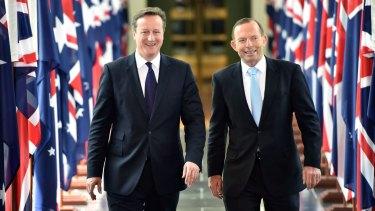 Talking tough on Russian aggression: British Prime Minister David Cameron (left) and Prime Minister Tony Abbott.