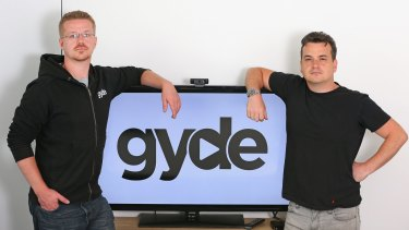 Tech entrepreneurs Scott Julian (R) and his brother Andrew Julian have developed an app called Gyde, a search engine for multiple TV streaming services.