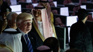 President Donald Trump listens during a ceremony to mark the opening of the Global Center for Combating Extremist Ideology in Riyadh on Sunday.
